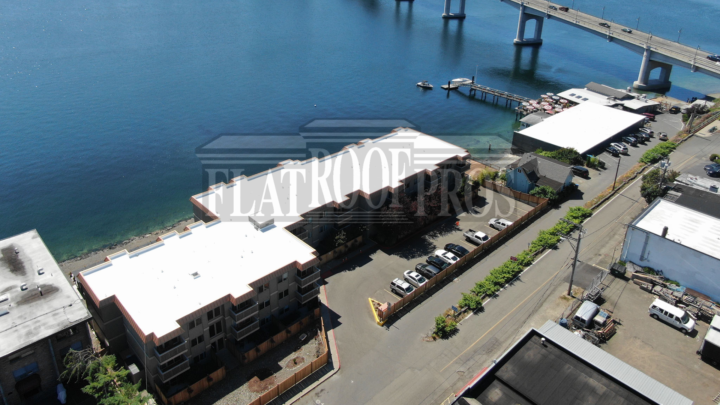 flat roof pros, reroof in seattle